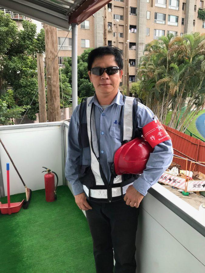 Tech Cube construction workers: Mr. Jiang and Mr. Sun
