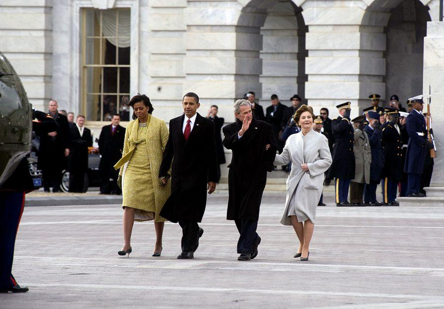 President Barack and First Lady Michelle Obama escort former President George W. Bush and former First Lady Laura Bush to a waiting helicopter. Photo courtesy of Chad J. McNeeley.