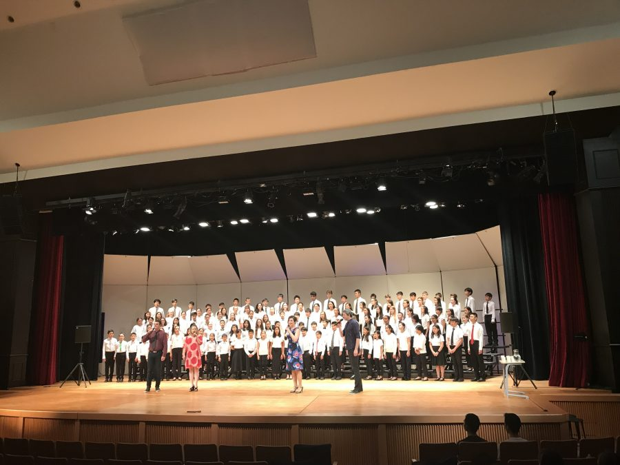 The+Idea+of+North+performs+a+song+with+TAS+choir+students.+%5BIan.H%2FThe+Blue+%26+Gold%5D