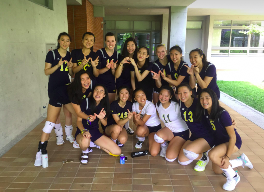 Varsity girls volleyball team pose for a photo after their win against Seoul Foreign School.