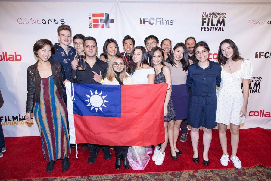 The film team poses on the red carpet proudly holding the Taiwan flag [PHOTO COURTESY OF THE FILM DEPARTMENT]