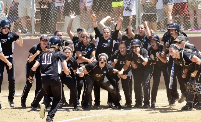 Ms. Hannah Limmer celebrating at home plate with her teammates after winning the NCAA Division II National Championship game in 2014. [PHOTO COURTESY OF MS. HANNAH LIMMER]