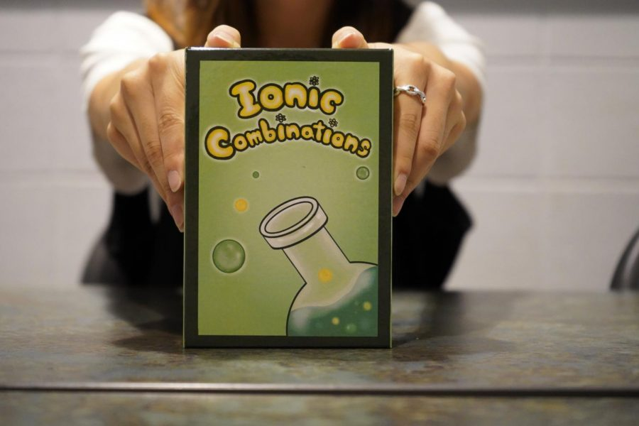Elaine T. ('22), a senior at Taipei American School, designed her own card game on solubility rules. [JAMES HAU/THE BLUE & GOLD]